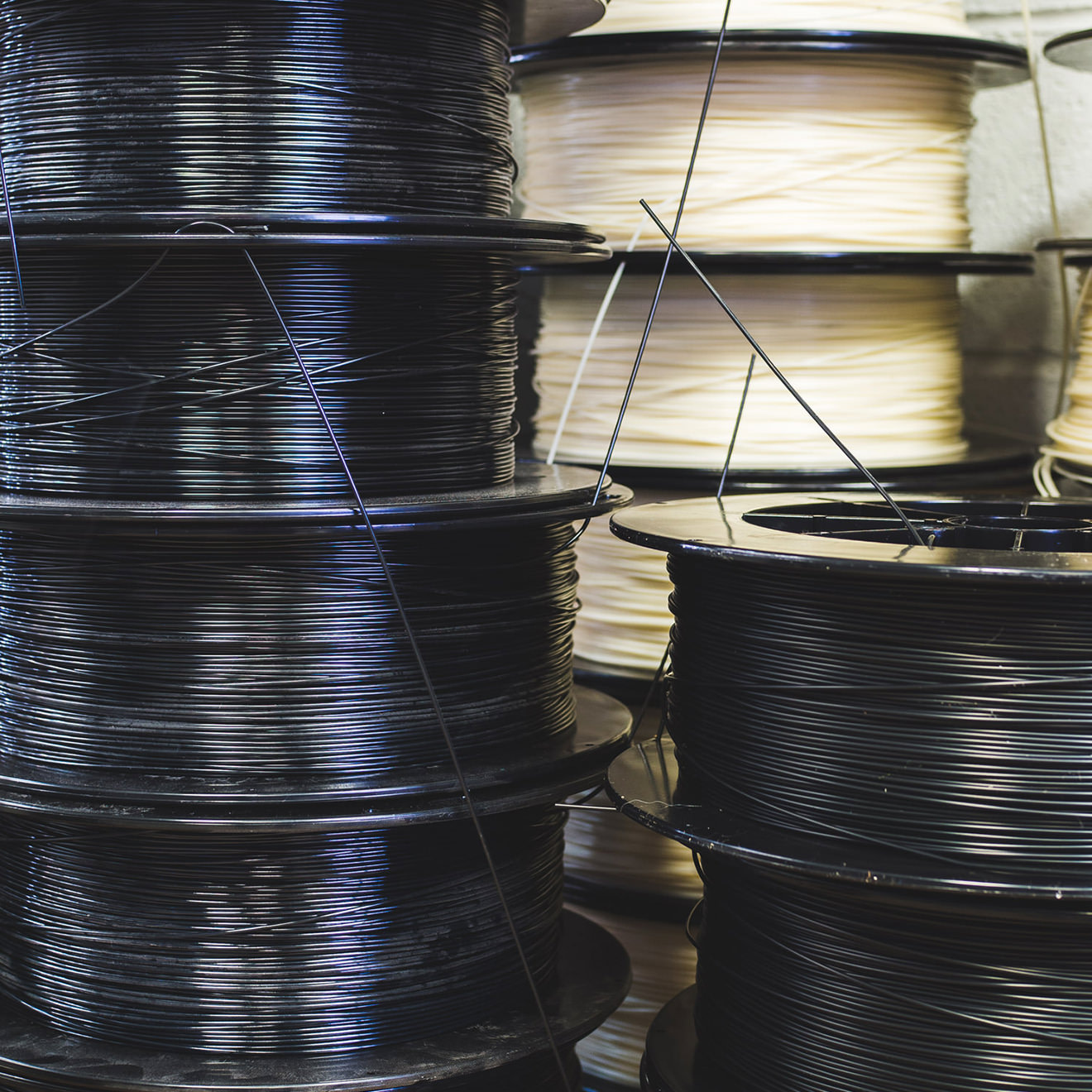 Black spools of 3D printing plastic