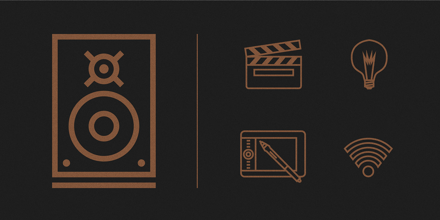 Bronze icons atop a black background depicting speakers, a lightbulb, wifi sign and tablet