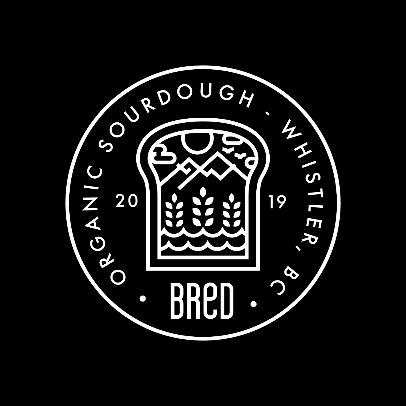 Black and white circle icon with the words: Organic Sourdough - Whistler, BC at its centre. The brand name Bred is also present, with the year 2019. The image at the centre is of a slice of bread with wheat grains, ocean waves, mountains and clouds at the centre.