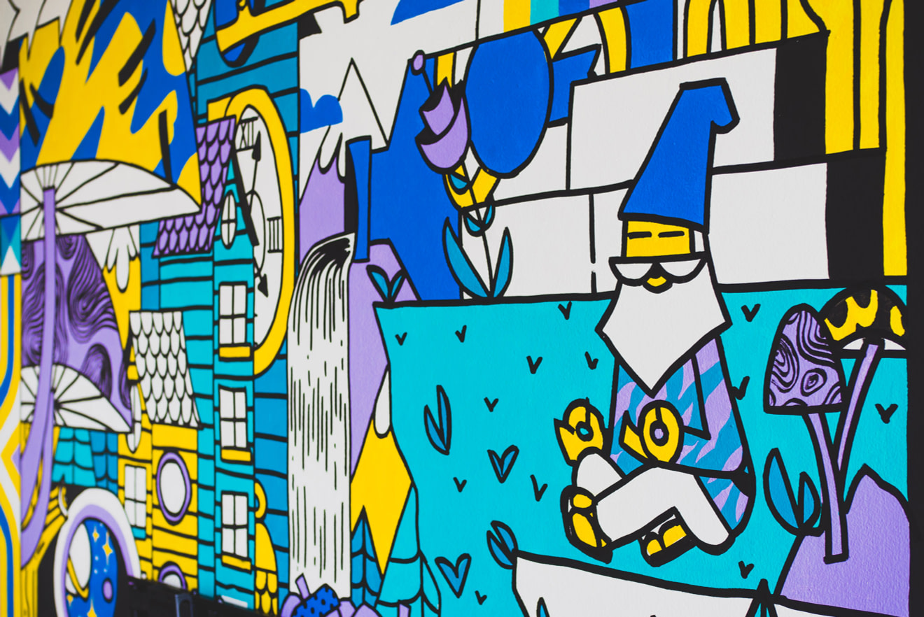 Fantastical mural in yellow, purple, teal and white depicting mushrooms, snails, a waterfall, a gnome, acorns and trees.