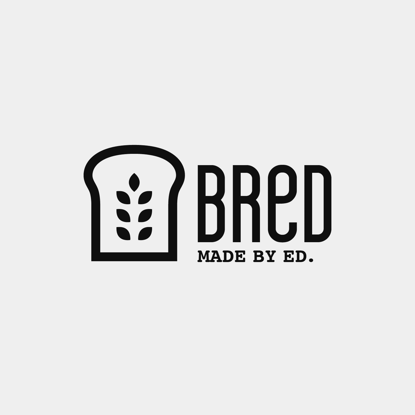 Black and white icon of a slice of bread with wheat leaves at its centre. The loco also reads Bred - Made by Ed