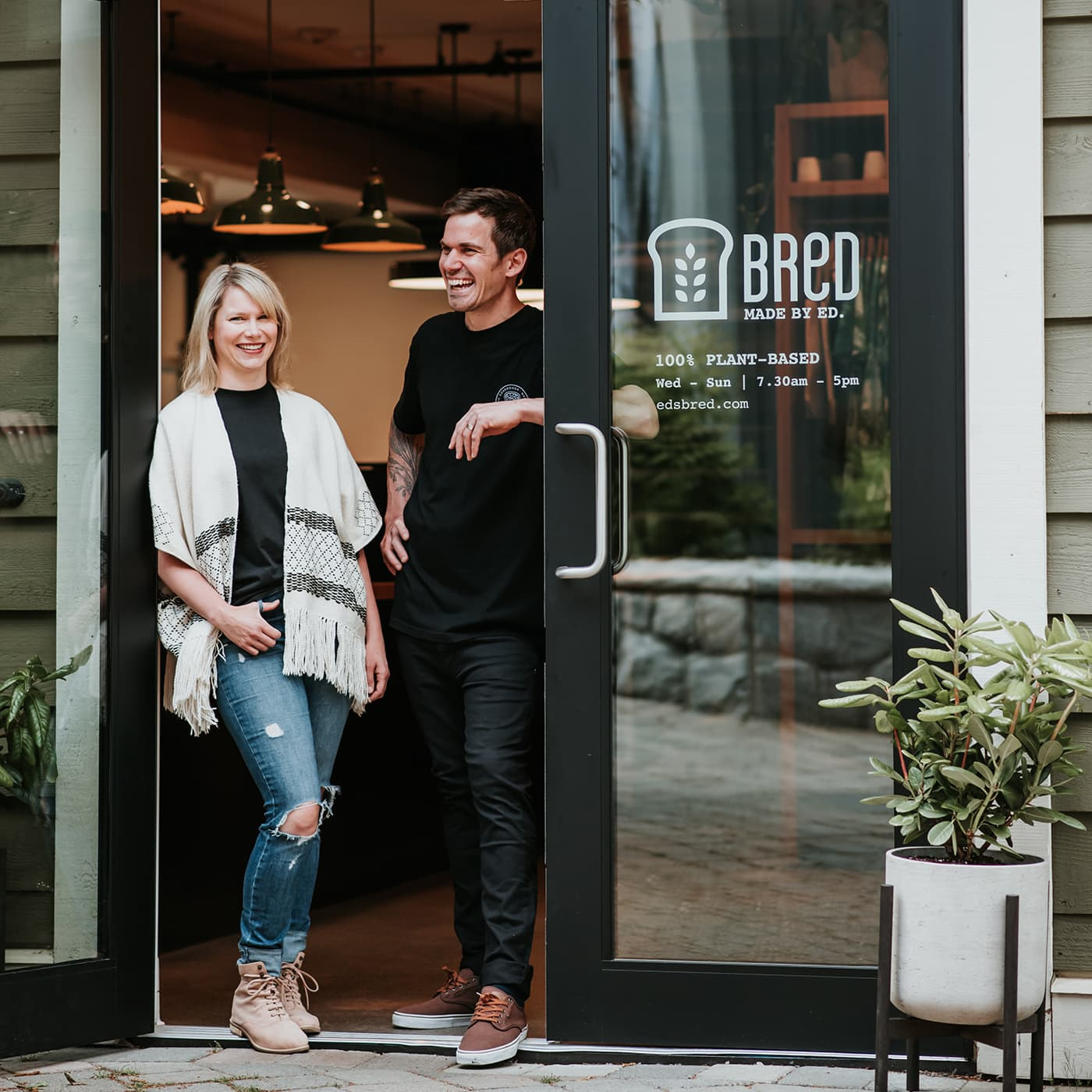 Man and woman standing in the doorway of a bakery