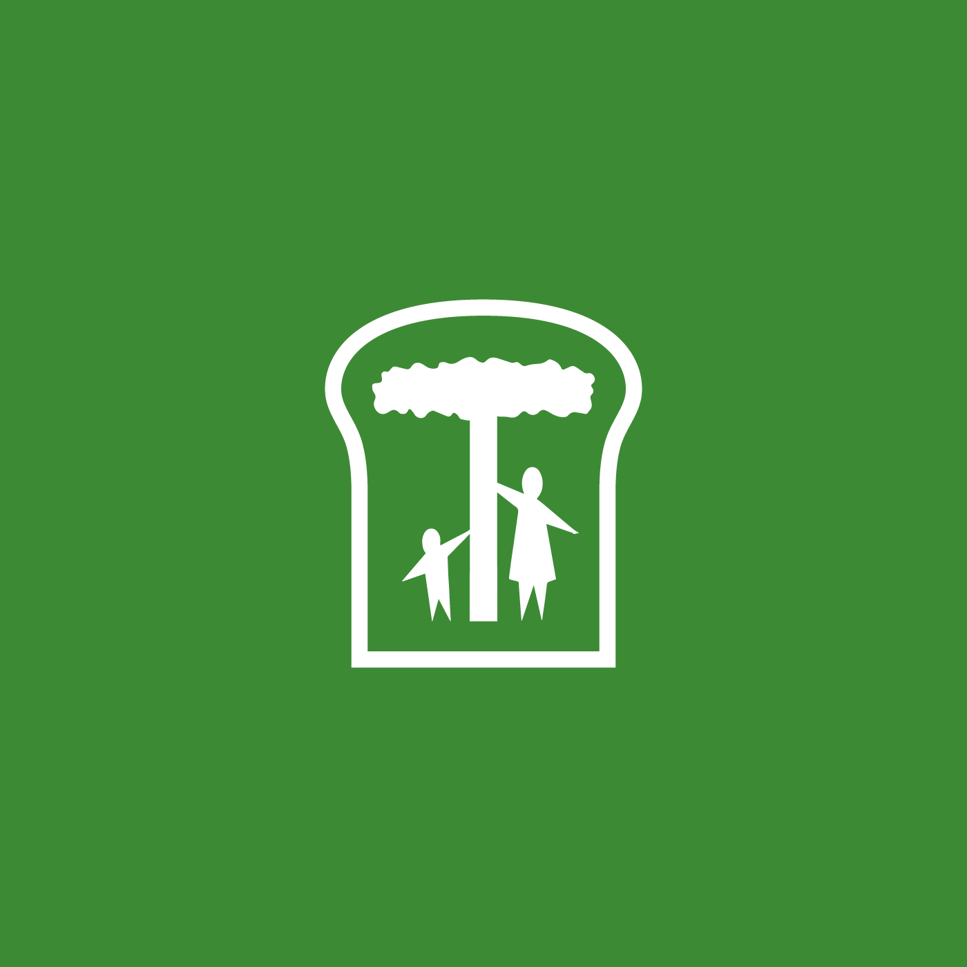 Green and white icon of a slice of bread. Inside, there is a mother and child standing underneath an African acacia tree
