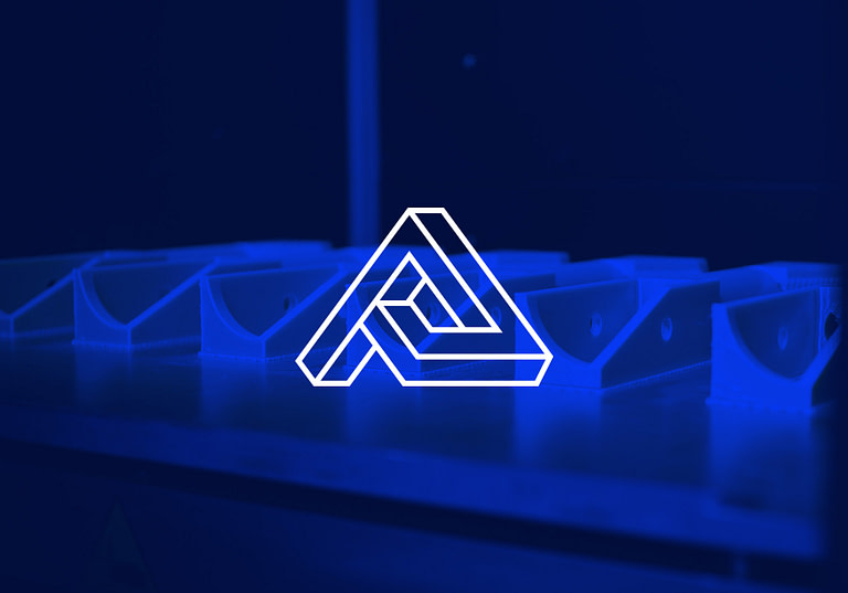Additive Polymers logo in white over a blue 3D image of plastic being printed