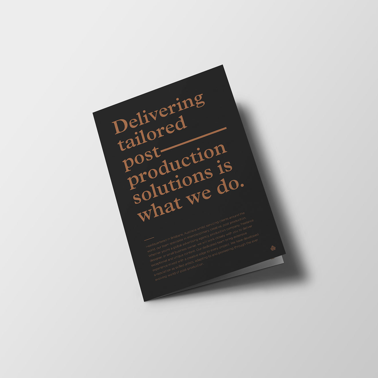 A black booklet that reads:Delivering tailored post production solutions is what we do.