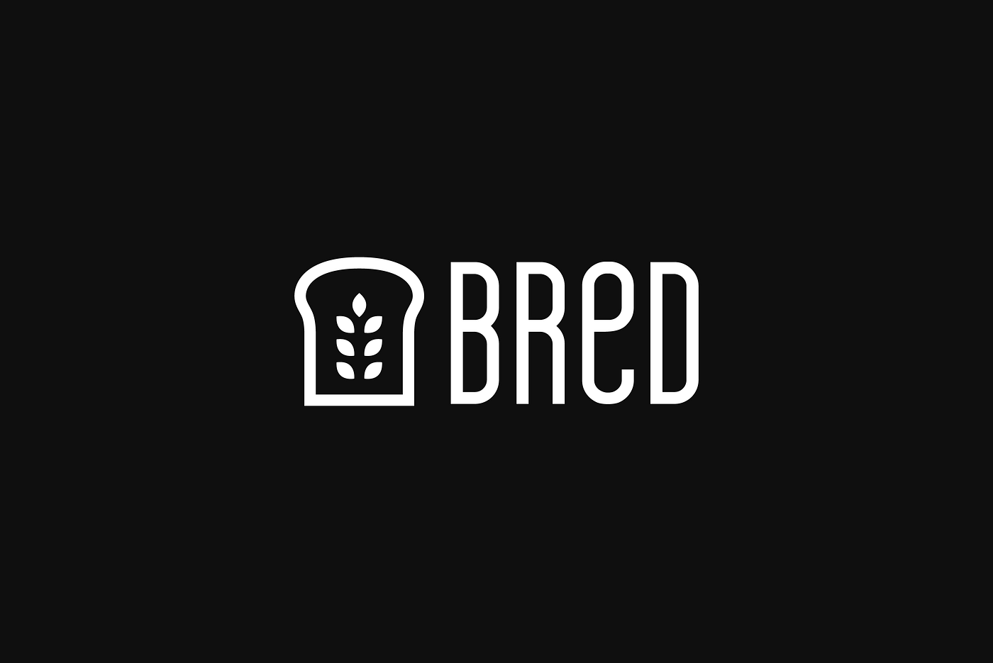 Black and white icon of a slice of bread with wheat leaves at its centre. The loco also reads Bred.